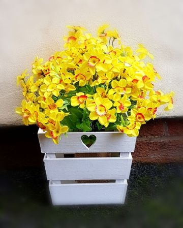 White Love Heart themed planter Filled with artificial daffodils